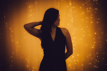 portrait of a woman standing in front of glowing light