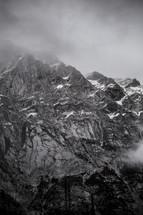 fog over jagged mountain peaks