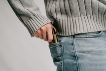 a man tucking his wallet into his back pocket