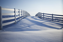 snow and white fence line
