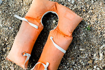 orange lifejacket on the ground