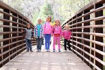 kids on a footbridge