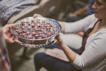 passing a tray of communion cups