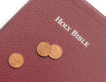 Holy Bible and Canadian coins