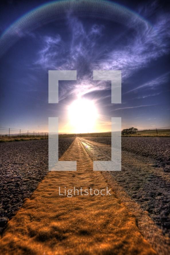 sun halo over road asphalt