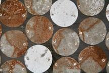 rusty circular metal pieces