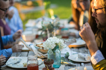 A family enjoying dinner together outdoors