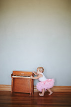 toddler girl and a piano