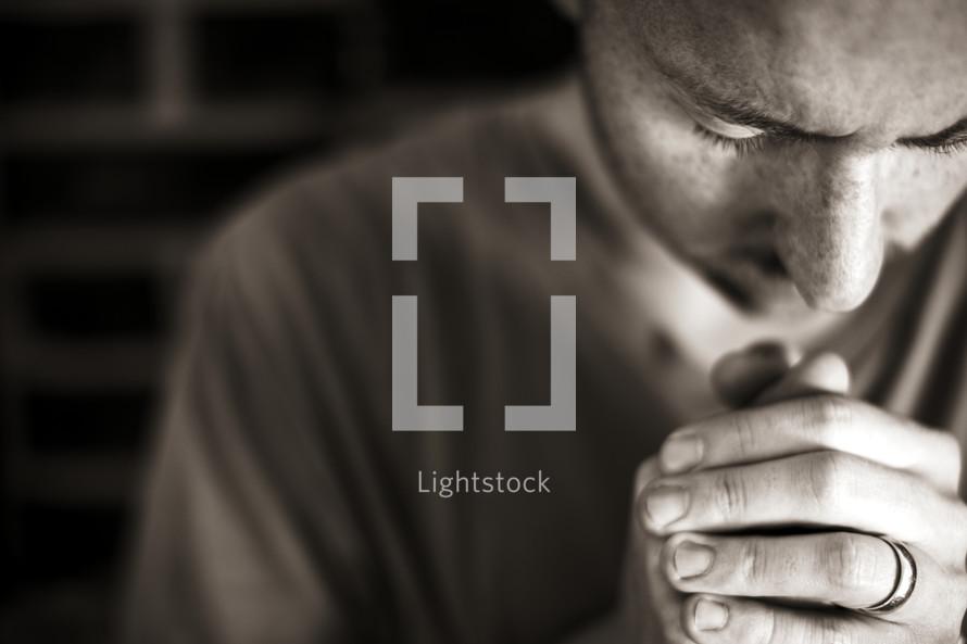 A married man praying