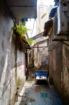 a cart in a narrow alley