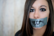 A woman with her mouth duct taped