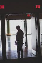man exiting a building