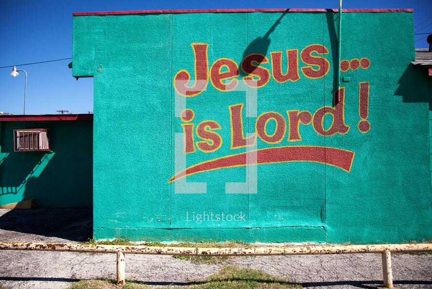 """""""Jesus Is Lord"""" written on building wall"""