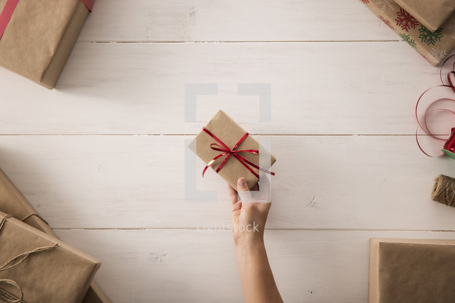 a woman holding a wrapping gift
