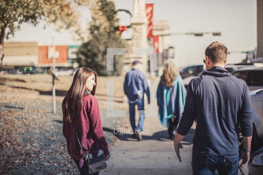 People walking along the sidewalk
