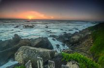 rocky beach shore at sunset