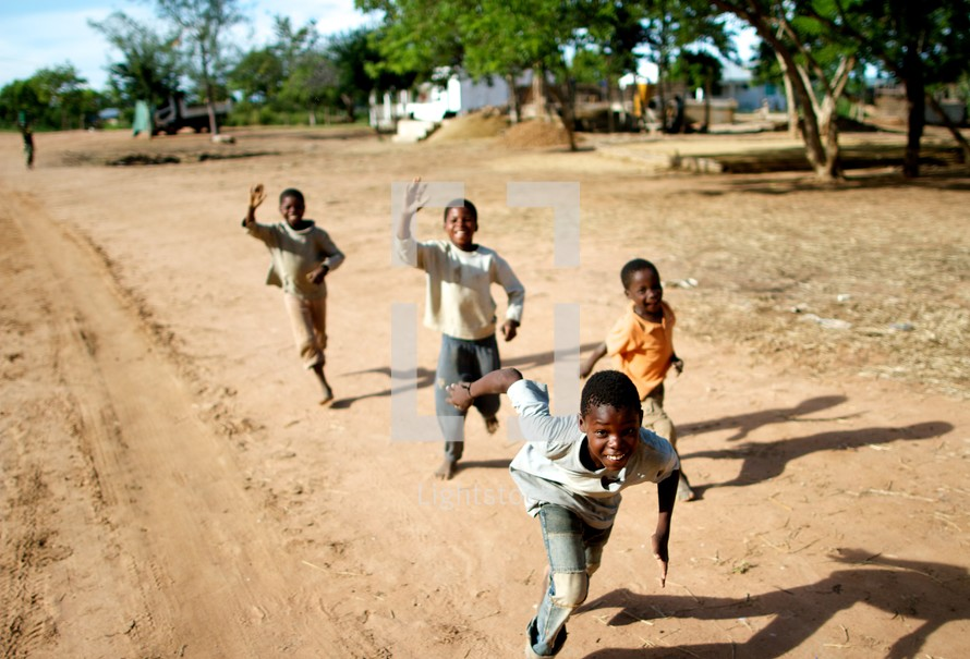 children chasing after a moving vehicle