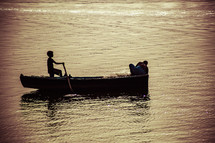 a child rowing a fishing boat