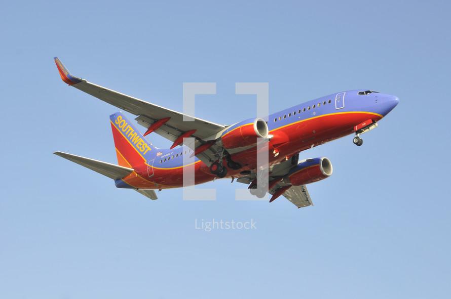Commercial airplane in flight. Boeing 737 passenger jet