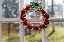 bell wreath in a window
