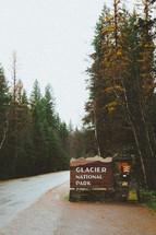 sign to the entrance for Glacier National Park