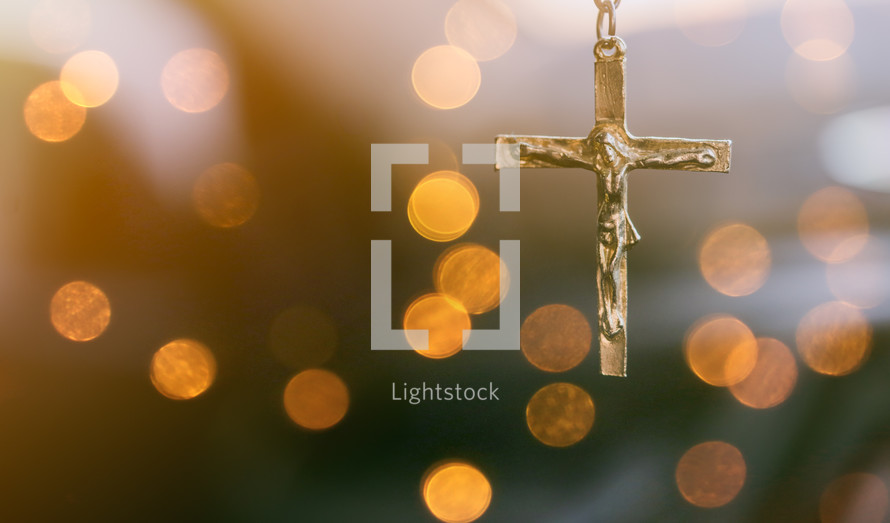 cross and blurry bokeh lights background