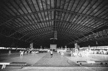 man walking in a large warehouse