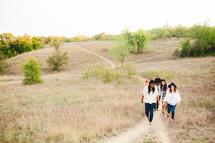 women walking up a path outdoors