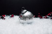 silver ornament in snow