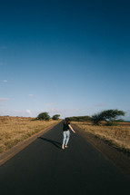 a woman running down a paved path