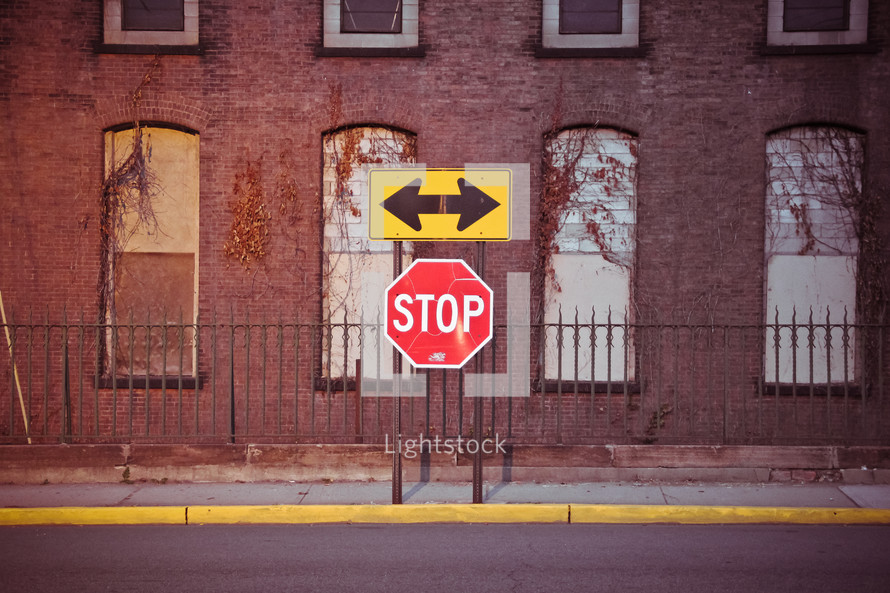 street sign and stop sign