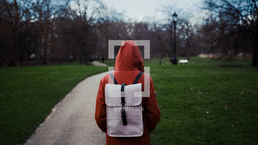 person with a backpack and rain jacket