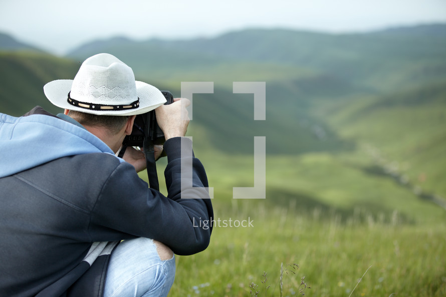 man taking a picture outdoors
