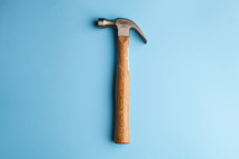 Hammer centered on a blue background.