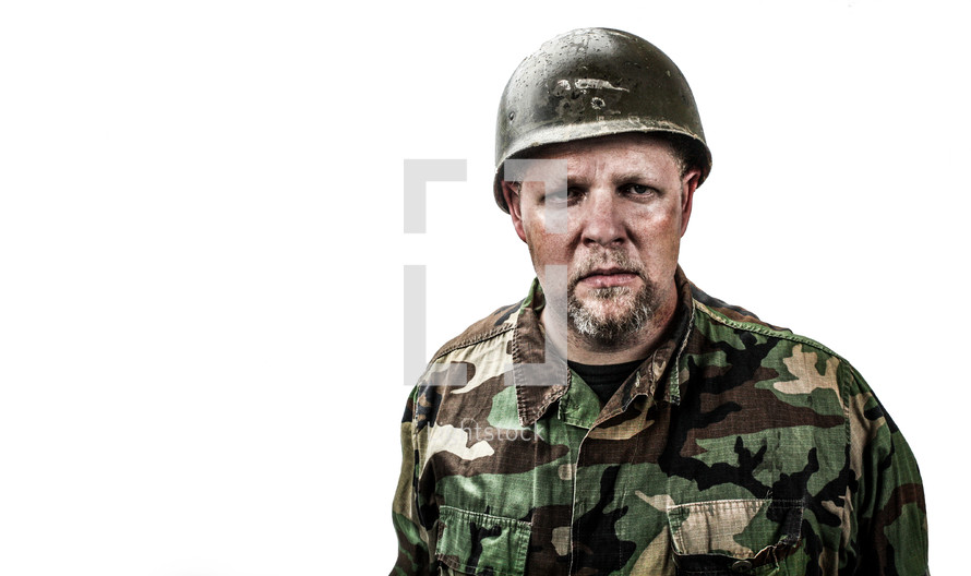 Soldier in camouflage uniform with helmet on white background.