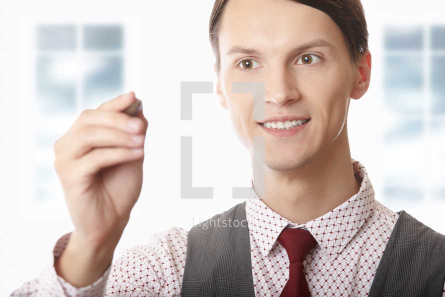 businessman holding a stylus