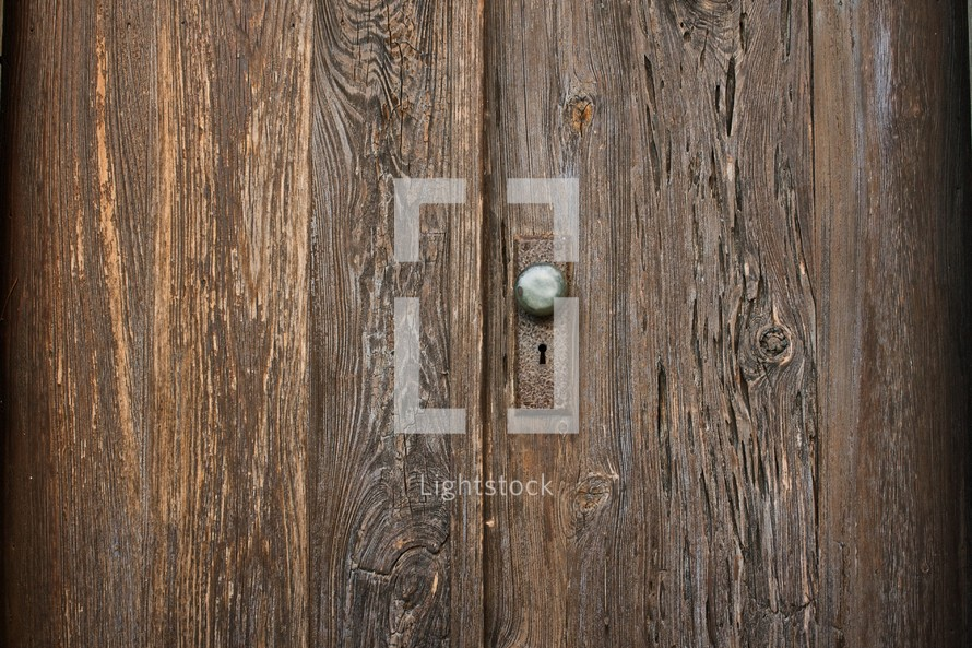 door knob on an old wooden door