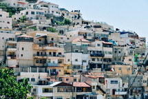 crowed apartment buildings on a mountainside