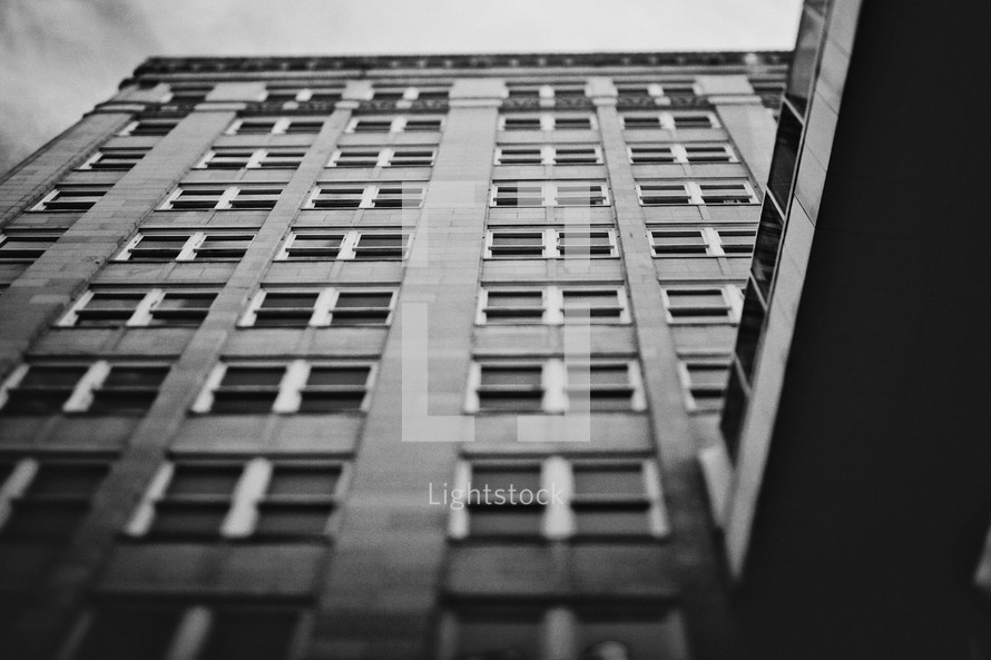 Looking up at tall building