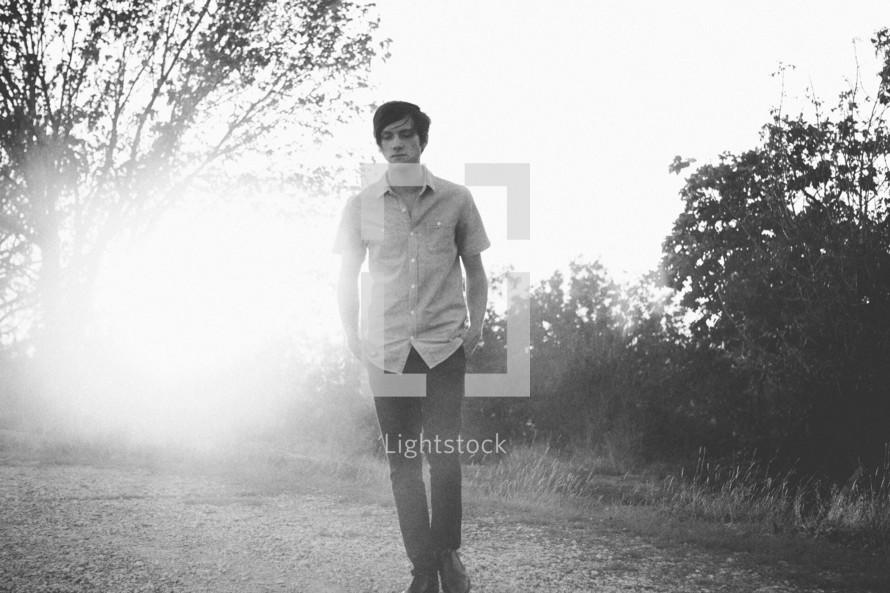 Teenager walking in a park