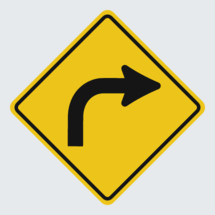 yellow turn road sign