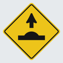 Speed bump ahead street sign