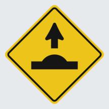 Speed bump ahead street sign