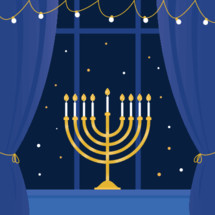 Lit Hanukkah Menorah in Window