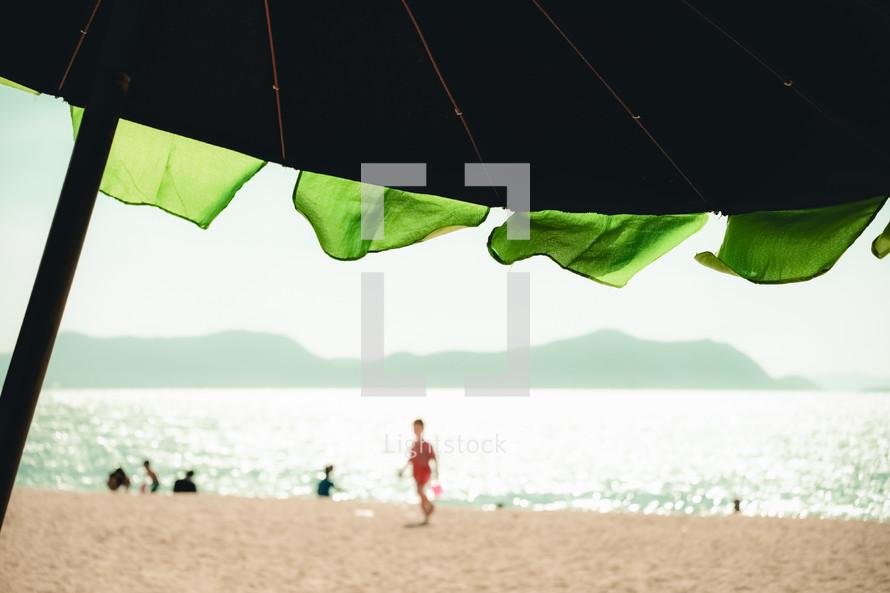 beach umbrella and kids on a beach