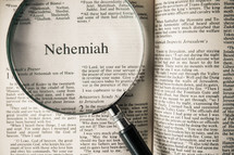 magnifying glass over Bible - Nehemiah