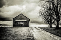 rural barn under a cloudy sky