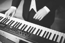 A man playing a keyboard