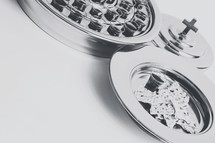 communion trays on a white background