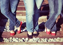 feet of teen girls on railroad tracks